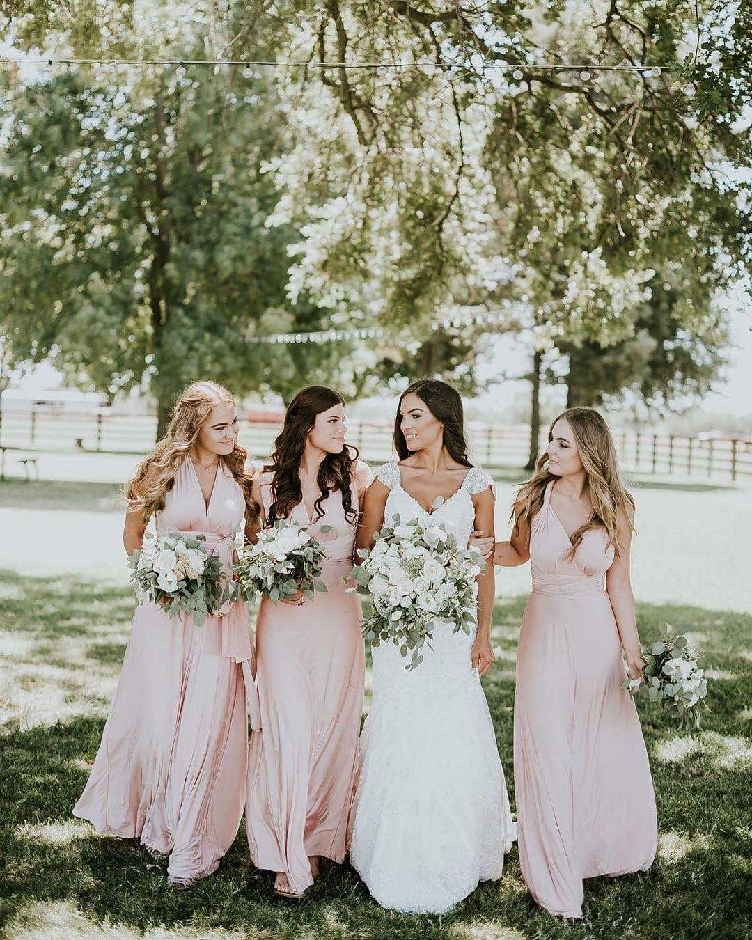 06865e316f9 Her bridesmaids are looking darling wearing our Always Stunning Convertible  Blush Pink Maxi Dress. Wedding dates filling up your calendar