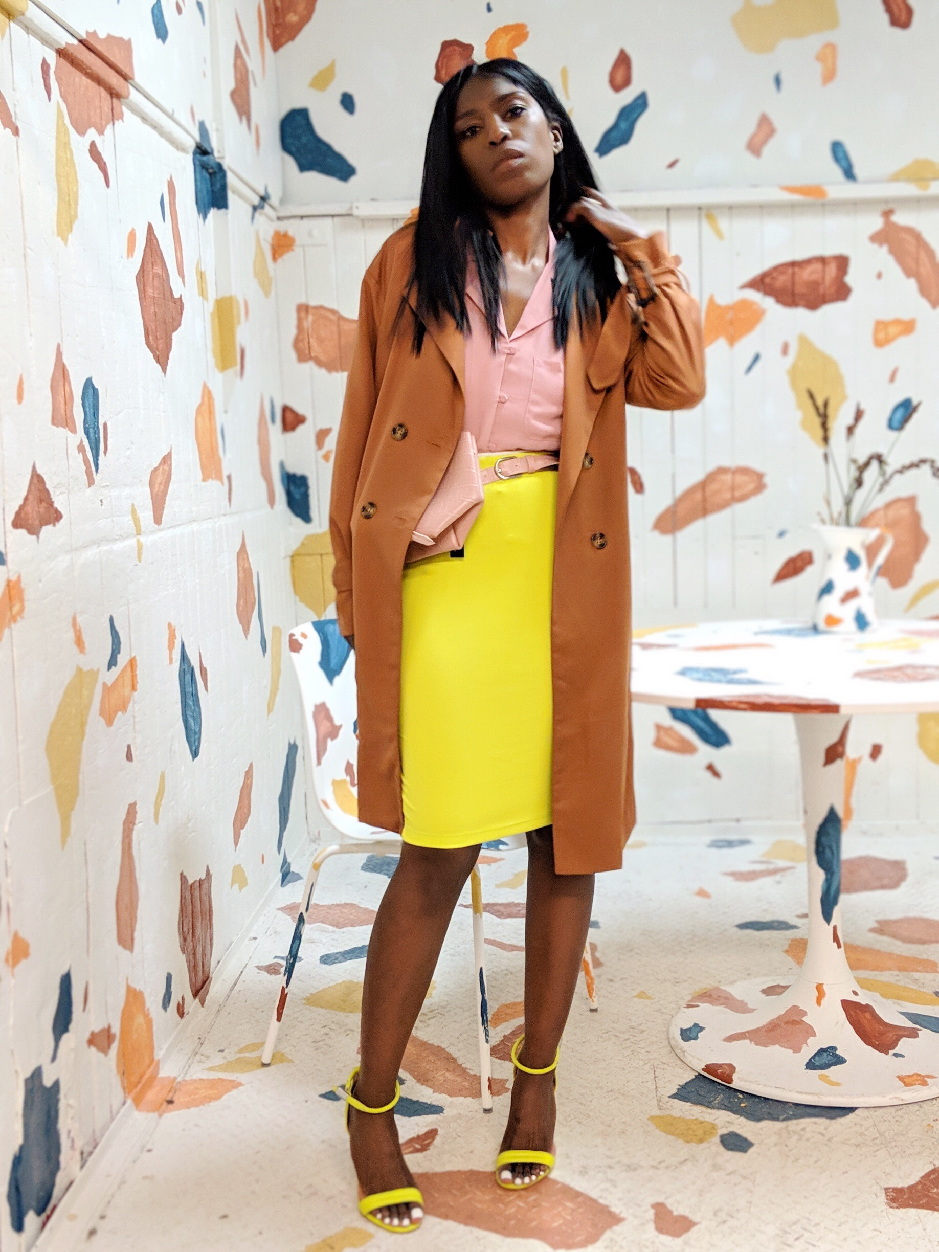 734684d4ef327 color block clothing trend - pink shirt and yellow skirt with trench coat
