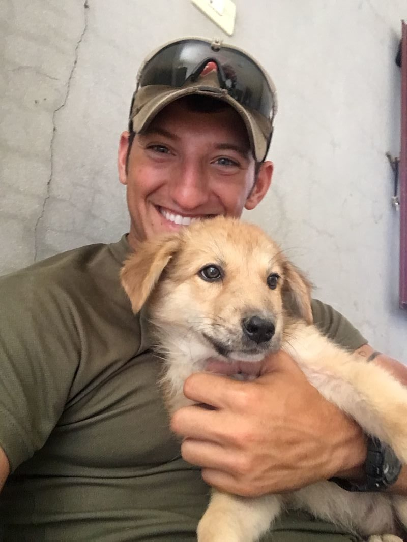 soldier and dog reunion photo: SPCAI staff and dog rescue: pets and mental health - pets for depression and anxiety - how do dogs help with anxiety - dogs and emotional health
